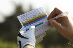 Writing golf handicap Stock Images