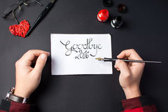 Writing a goodbye 2016 card Stock Photography