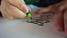 Writing Gothic calligraphy with ink pen. Writing Gothic calligraphy with ink pen close up stock footage