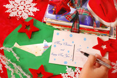 Writing greeting cards for christmas. Hand writing traditional greeting cards for christmas to family or friends Royalty Free Stock Photos
