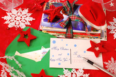 Writing greeting cards for christmas. Writing traditional greeting cards for christmas to family or friends Royalty Free Stock Image
