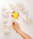 Writing hand in crumpled paper Stock Images