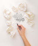Writing hand in crumpled paper Royalty Free Stock Image