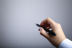 Writing Hand With Gradually Varied Background Royalty Free Stock Photography