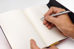 Writing hand on notebook Royalty Free Stock Photography