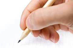Writing. An hand who writes in a paper sheet Royalty Free Stock Photo