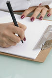 Writing hands with notepad Royalty Free Stock Photography