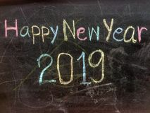 Writing Happy New Year on blackboard. royalty free stock image