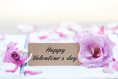 Writing happy valentine on card Royalty Free Stock Image