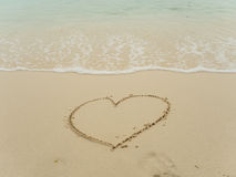 Writing heart on beach Royalty Free Stock Photo