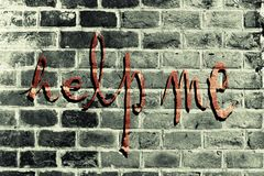 The writing Help Me on the wall Stock Image