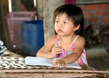 Writing her homework Royalty Free Stock Photo