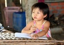 Writing her homework Royalty Free Stock Photo