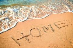 Writing Home on the Beach Stock Photo
