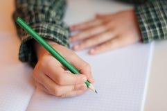 Writing homework Stock Images