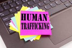 Writing Human Trafficking text made in the office close-up on laptop computer keyboard. Business concept for Slavery Crime Prevent Royalty Free Stock Image