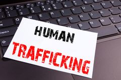 Writing Human Trafficking text made in the office close-up on laptop computer keyboard. Business concept for Slavery Crime Prevent Stock Photography