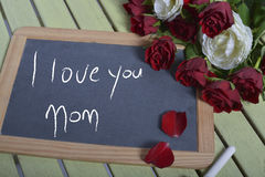 Writing I love you mother on the slate Royalty Free Stock Photos