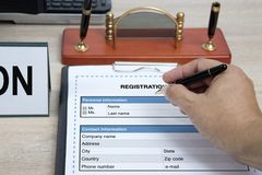 Writing information to blank registration form. Royalty Free Stock Photo