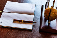 Writing instruments. Desktop. pen, diary, stand, organizer, Globe, notebook. Royalty Free Stock Images