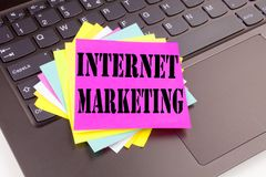 Writing Internet Marketing text made in the office close-up on laptop computer keyboard. Business concept for Technology Strategy Royalty Free Stock Image