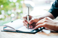 Writing a journal Royalty Free Stock Images