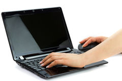 Writing on laptop Stock Photo