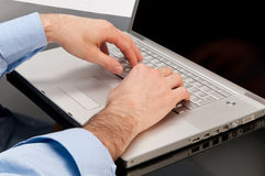 Writing on laptop Stock Image