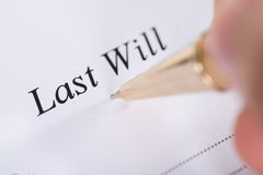 Writing last will and testament. Closeup shot royalty free stock images