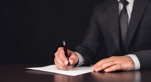 Writing Legal Document. Businessman Writing A Legal Document stock image