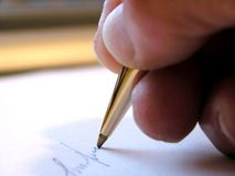 Writing a letter. With a ballpoint pen Stock Images