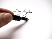 Writing a letter. With an ink pen Royalty Free Stock Photos