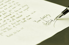 Writing letter as in old times. Official letters handwritten using fountain pen in early days Royalty Free Stock Photo