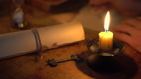 Writing letter in candlelight stock video footage