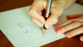 Writing Letter.Close up of an old fashioned fountain pen writing on a piece of paper. Close up of an old fashioned fountain pen writing on a piece of paper, real stock footage