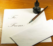 Writing a Letter with Envelope. Calligraphy set with pen and ink and letter and envelope Stock Photos