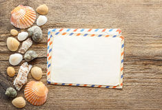 Writing a letter from holiday. Seashelles on a wood Stock Photos