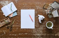 Writing a letter on individual and inspirational workspace flowers and pictures. Charming work environment royalty free stock photos