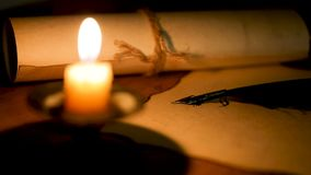 Writing letter with quill pen in the light of candle stock video