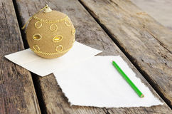 Writing letter to Santa Claus on the vintage wooden table Royalty Free Stock Photos