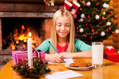 Writing a letter to Santa. Stock Image