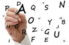 Writing letters of alphabet Stock Photo