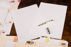 Writing letters. Writing paper, pen and some old letters, a backround Royalty Free Stock Images