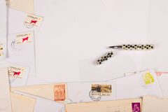 Writing letters. Writing paper, pen and some old letters, a backround Royalty Free Stock Photo