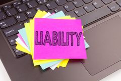 Writing Liability text made in the office close-up on laptop computer keyboard. Business concept for Accountability Legal Blame Ri. Sk Workshop on the black Royalty Free Stock Photography