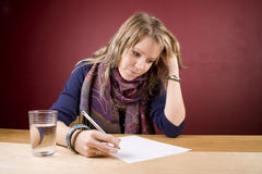 Writing List. Pretty, young woman writing a list Royalty Free Stock Photo