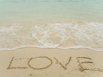 Writing love on beach Royalty Free Stock Photography
