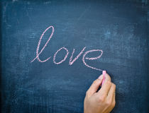Writing love with chalk Royalty Free Stock Image