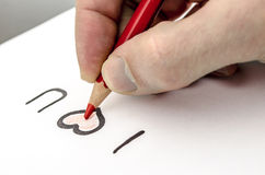 Writing a love message Royalty Free Stock Image