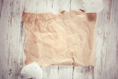 Writing love message. Brown package paper and love hearts on wooden background Stock Photography